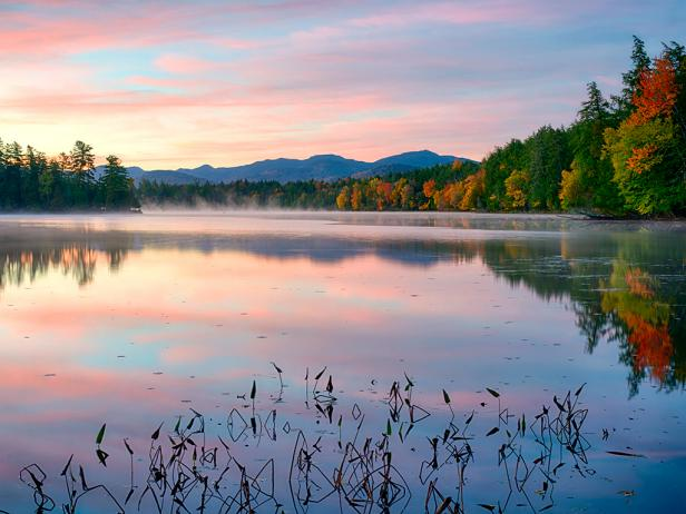 dawn, lake, trees with colored leaves, mountains in distance